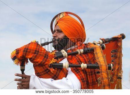 Bikaner, Rajasthan, India - January 11, 2020: Indian Bagpiper Playing Bagpipe During Camel Festival
