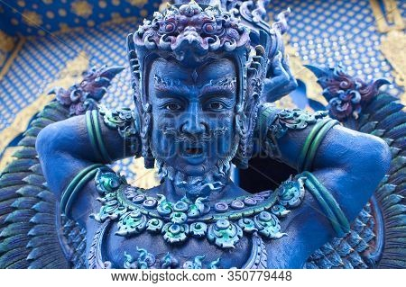 Blue Statue Of The Winged Guard In Thai Lanna Style - Detail Of Exteror Of Wat Rong Suea Ten, Or Blu
