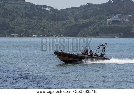 Lisboa, Portigal - April 2018: Boat At Tagus River At The City Promenade