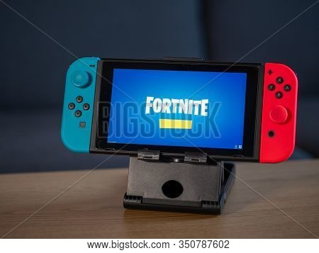 Uk - Feb 2020: Nintendo Switch With Fortnite Game Logo On Screen In Home