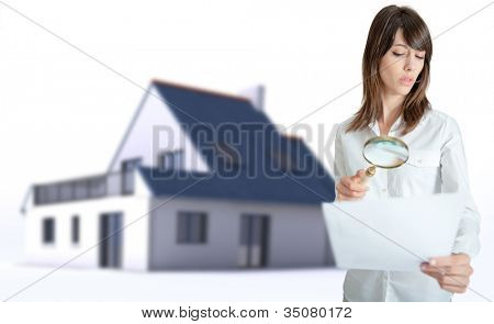 Woman scrutinizing a document with a house in the background
