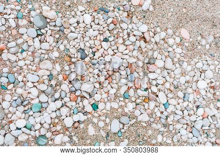 Colorful Sea Pebbles Abstract Background. The Texture Of The Pebbled Beach.