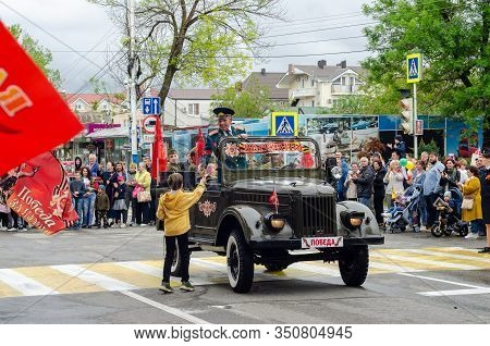 Anapa, Russia - May 9, 2019: Children Give Flowers To Veterans Driving A Restored Military Car At Th