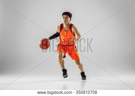 Young Basketball Player Of Team Wearing Sportwear Training, Practicing In Action, Motion In Run Isol