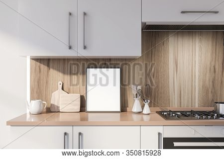 Poster On White Countertop In Wooden Kitchen