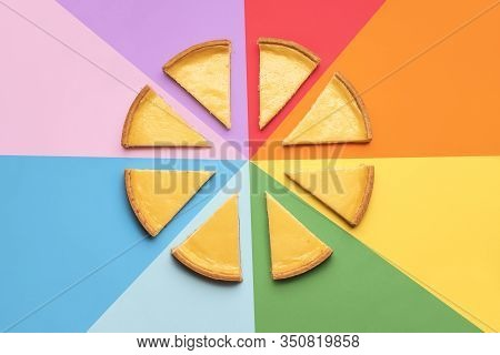 Homemade Cheesecake Sliced In Portions On A Rainbow Background. Sliced Cheese Cake On Colorful Backg