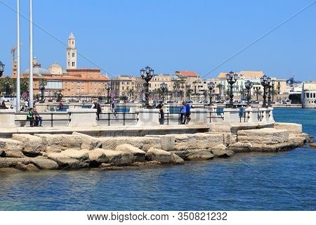 Bari, Italy - May 28, 2017: People Visit Lungomare Boulevard In Bari, Italy. Bari Is The Capital Cit