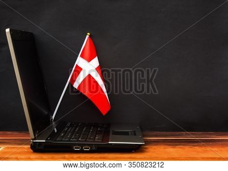 Flag Of Denmark , Computer, Laptop On Table And Dark Background