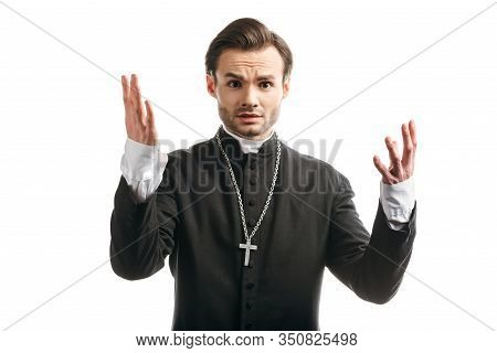 Discouraged Catholic Priest Showing Shrug Gesture While Looking At Camera Isolated On White