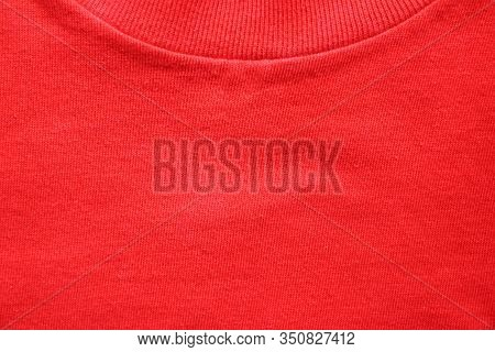 Round Collar Neck Red T-shirt Close Up. Empty Colorful Red Fabric Texture, Casual Shirt Detail Of Co