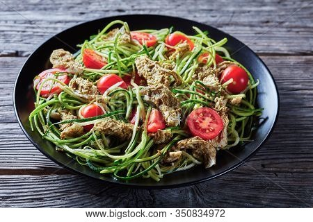 Basil Chicken Breast Zucchini Noodles Tomato Salad On A Black Plate On A Rustic Wooden Table, Horizo