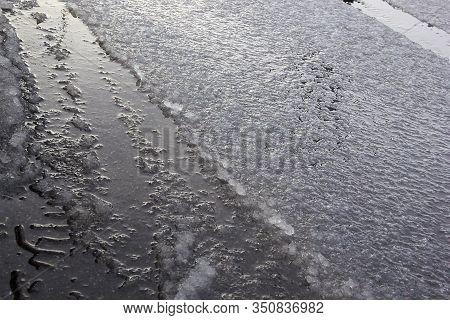 Slush Dampness On The Road Sleet Even Layer