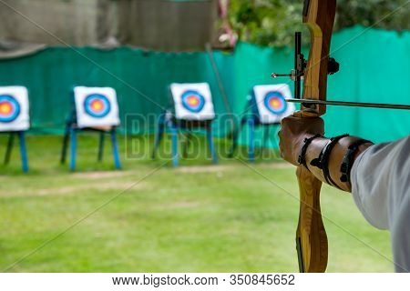Archer Takes Aim At A Target