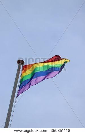 A Rainbow Gay Pride Flag On A Tall Flagstaff