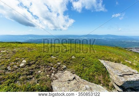 Rocks On The Alpine Meadow. Wonderful Summer Scenery Of Runa Mountain. Rural Valley In The Distance.