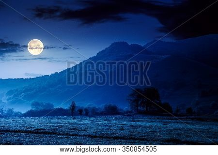Rock Formation On The Field At Night. Beautiful Rural Landscape In Mountains. Wonderful Scenery In S
