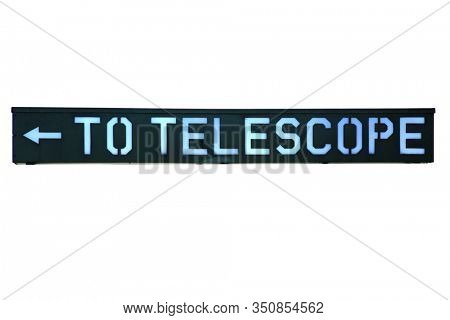 Telescope Sign. Metal Sign with words reads TO TELESCOPE with an Arrow pointing to the left. Isolated on white. Room for text. Clipping Path. Telescopes are used world wide to view stars and planets.