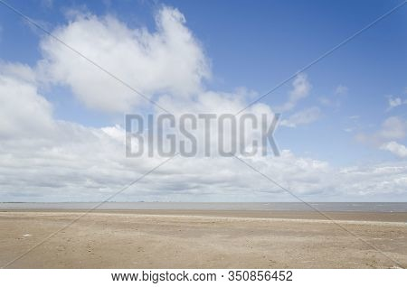 Generic Beach Landscape, Empty; Sand And A Sunny Sky With Some Clouds. Punta Rasa, Argentina