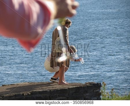 Oslo, Norway - Circa August 2017: Unidentified Girls By The Sea