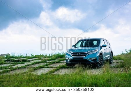 Mnt. Runa, Ukraine - Jun 22, 2019: Blue Suv On A Paved Meadow. Popular Awd Vehicle In Nature Scenery