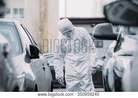 Selective Focus Of Asian Epidemiologist In Hazmat Suit And Respirator Mask Inspecting Vehicles On Pa