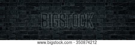 Wide Black Brick Wall Texture. Rough Shabby Brickwork Widescreen Backdrop. Dark Gray Panoramic Gloom