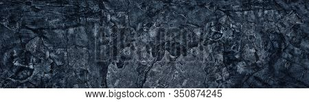 Dark Blue Weathered Broken Concrete Surface Panoramic Texture. Old Cracked Cement Wide Background