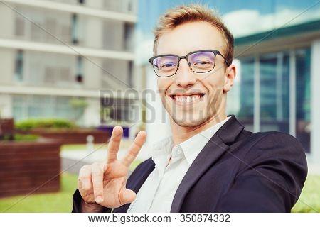 Happy Positive Entrepreneur Taking Selfie In Urban Settings. Self Portrait Of Handsome Young Busines