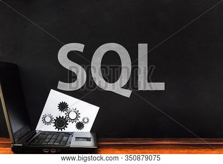 Sql Programming Language. Laptop And Word Sql On Dark Wall. Structured Query Language