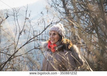 Beautiful Woman Smiling In Nature. Happy People Lifestyle. Woman Smiling In Sunshine In Forest. Natu