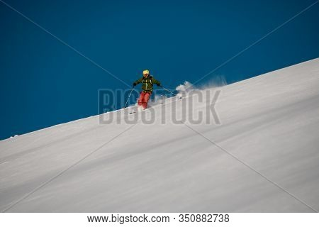 Brave Freerider Slides Down On The Mountain Side