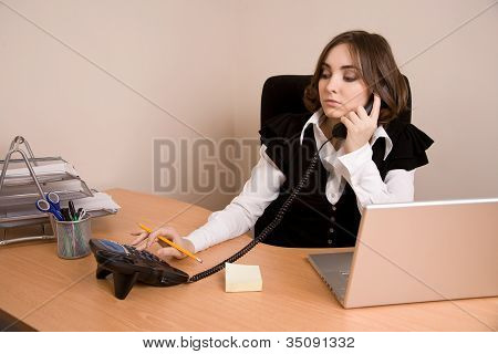 Young Secretary With  Telephone And Laptop