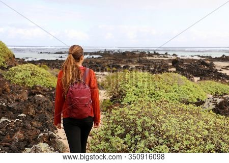 Hiking In Spring Time. Back View Of Girl Exploring The Northern Of The Island Of Lanzarote, Canary I