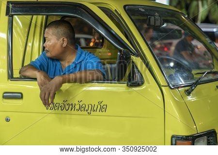 Thailand, Phuket, Patong, February 1, 2020: Blurr, Soft Focus, Tuk Tuk Driver, Thai Man Sitting In H