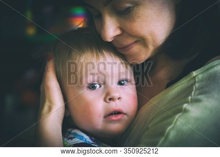 Close Up Portrait Of Beautiful Mother With Her 2 Years Old Son, Care And Love, Loving Parents