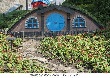 Kiev, Ukraine. Juny 20 2019 The Little Hobbit House. Themed Flowerbed In The Park