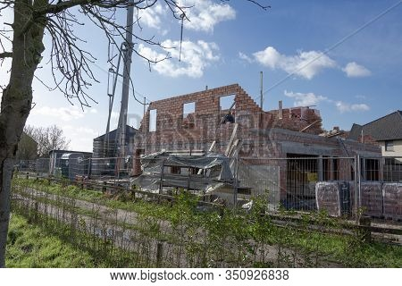 Sint Gillis Waas, Belgium, February 12, 2020. The Side Of A House Under Construction In Red Brick, A