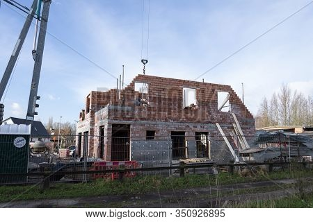 Sint Gillis Waas, Belgium, February 12, 2020. The Side Of A House Under Construction, There Is Used