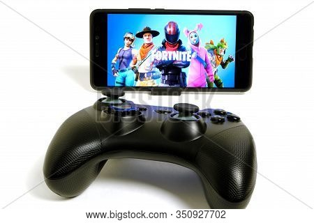 Kostanay, Kazakhstan, February 12, 2020.joystick And Mobile Phone With The Logo Of The Popular Game