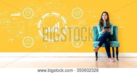 Marketing Concept With Young Woman Holding A Tablet Computer