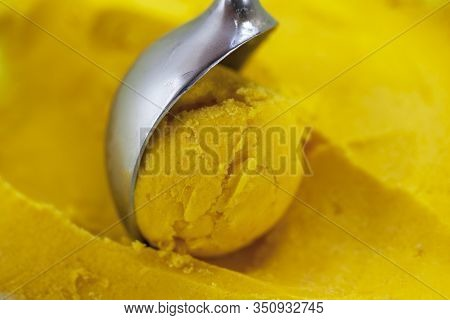 Blueberry-flavored Ice Cream With Mango Pulp, Yellow Fruit Flavored Ice Cream With A Bowl Close-up