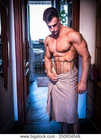 Handsome Shirtless Muscle Young Man Going Out Of Shower In Room.