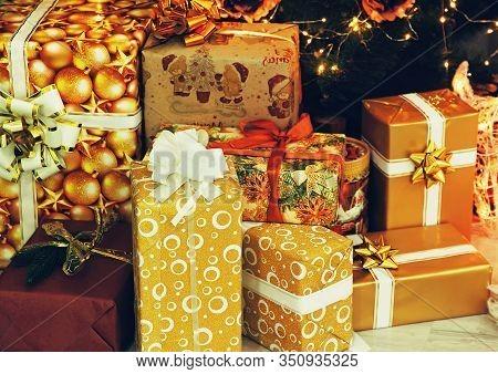 New Year. Christmas. Christmas Gift Boxes Near Christmas Fir-tree Taken Closeup.