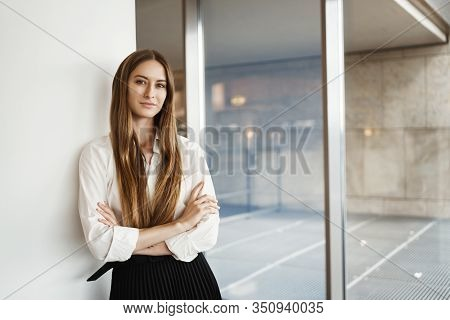 Successful Young Businesswoman Lean Wall And Cross Hands On Chest, Smiling Confident And Assertive,