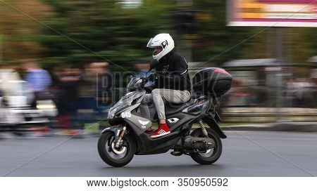 Bucharest, Romania - October 11, 2018: An Employee On Motor Scooter Of The Fast Courier Company Fan