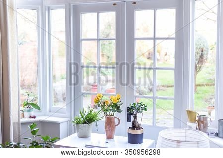 Stylish Room Interior With French Doors And Light Neutral Colours In A Modern Home