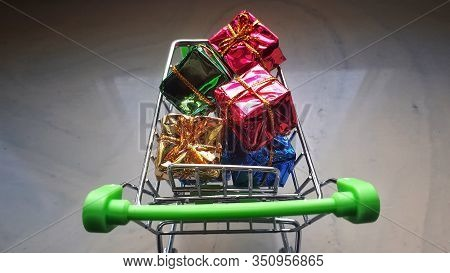Mini Shopping Trolley With Full Of Gift In Inside. Top View. Shopping Cart Concept Or Business Or In