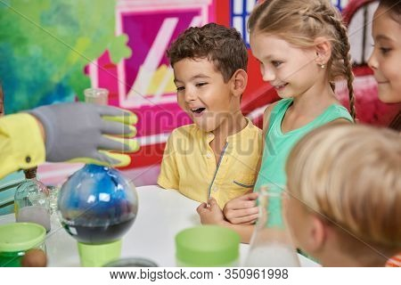 Science Show For Kids. Animator Holding Laboratory Glassware With Colored Liquid. Steaming Liquid On