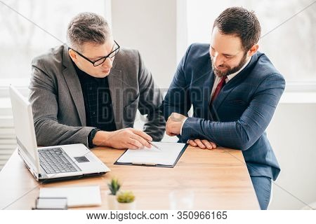 Job Interview, Employee Hiring. Boss Interviewing A Young Male Candidate. Modern Office Routine, Emp