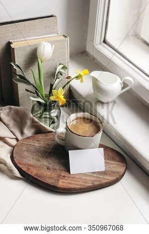Cozy Easter Spring Still Life. Business Card Mockup Scene. Cup Of Coffee, Books, Wooden Cutting Boar